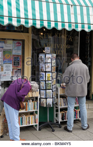 People browsing outside of a bookshop in South Street, Dorchester, Dorset, England - Stock Photo