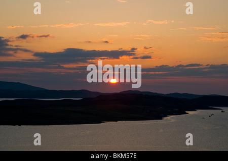 Sunset over Isle of Ewe & Loch Ewe at Aultbea Highland Scotland - Stock Photo