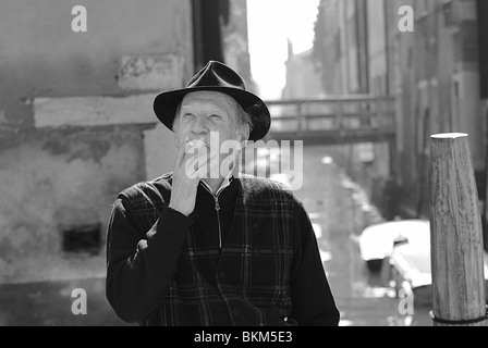 Black and white portrait of an elederly Italian man smoking a cigarette on a bridge in Venice, Italy - Stock Photo