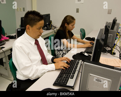 Hispanic male and female high school students type on computers at Mission Early College High School in El Paso, - Stock Photo