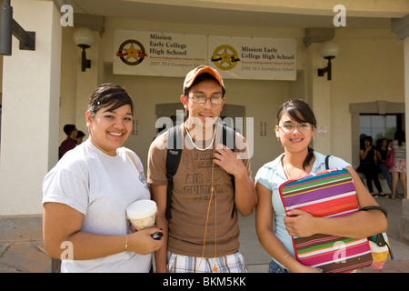 Hispanic students in front of entrance to Mission Early College High School in El Paso, Texas. - Stock Photo
