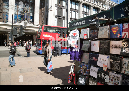 An Oxford Street stall opposite the entrance to Selfridges store, Oxford St, London, UK - Stock Photo