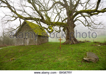 The chapel of Mas Staint-Jean on a foggy spring morning, Saint-Sulpice-le-Dunois, La Creuse, Limousin, France - Stock Photo