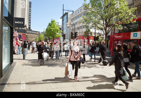 Shoppers, shopping on a sunny day in summer; Oxford Street, London UK - Stock Photo