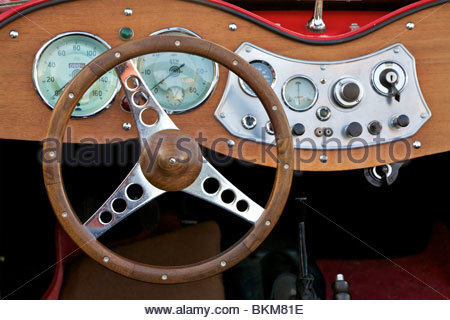 Dashboard and steering wheel of a MG T-Type antique car from the early 1950's. Leipzig, Germany. - Stock Photo