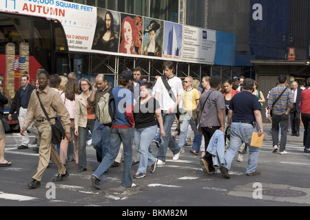 the always busy corner of 5th Avenue and 42nd St. in Manhattan by the New York Public Library - Stock Photo