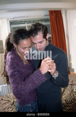Couple doing a classic dance at home - Stock Photo
