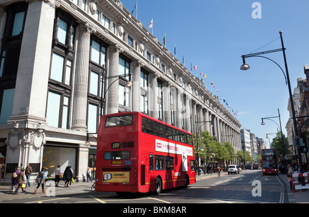 Buses outside Selfridges store on a sunny day in summer, Oxford Street, London UK