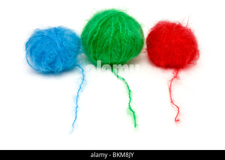 A line up of red, green and blue balls of mohair wool isolated against white background. - Stock Photo