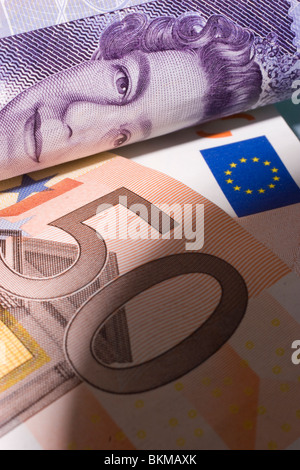 Sterling twenty pound note with euro note currency of united kingdom and Eurozone - Stock Photo