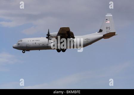 US Air Force Lockheed Martin C-130J-30 Hercules cargo plane. Military air transport. - Stock Photo