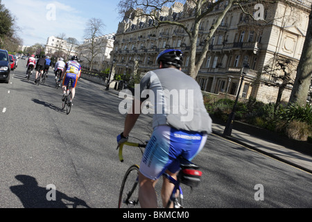 Cyclists out and about during a beautiful Spring day,Outer Circle in Regents Park is their choice of venue. - Stock Photo