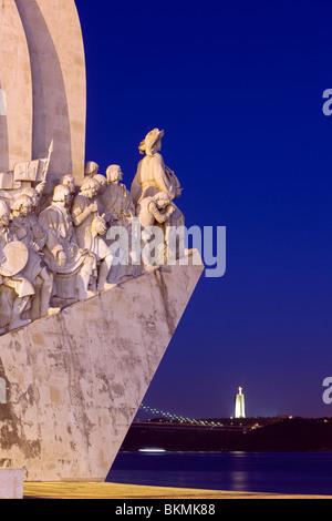 Monument to the Discoveries and the Monument to Christ in the distance at twilight, Lisbon, Portugal - Stock Photo