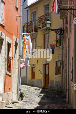 Portugal, Lisbon, typical small street in the Alfama district - Stock Photo