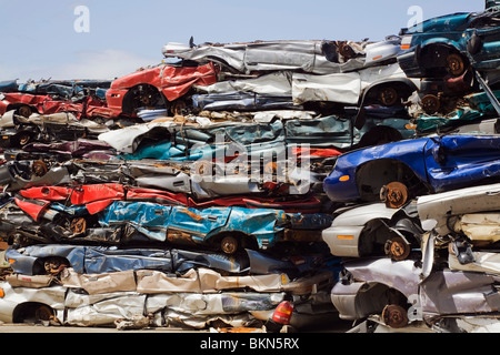 Quebec, Canada; Stacked And Crushed Automobiles At A Scrap Metal Recycling Junkyard - Stock Photo