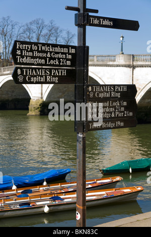 Lamp post with direction sign / signs for Thames Path; Capital Ring; Twickenham. Nr Richmond Bridge, Richmond upon - Stock Photo