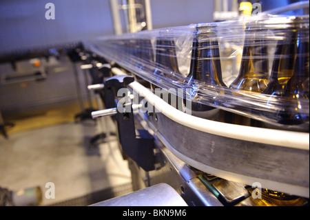 Empty bottles on a bottling machine, Hitachino Nest Beer, Ibaraki, Japan, February 28, 2010. - Stock Photo