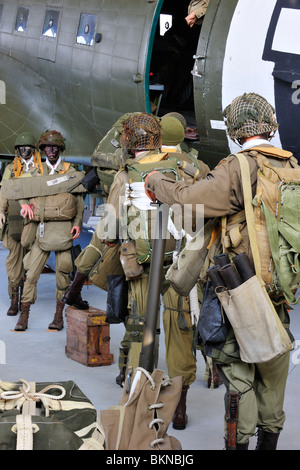 WW2 uniforms of American soldiers and Douglas C-47 airplane in the Airborne Museum at Sainte-Mère-Église, Normandy, - Stock Photo