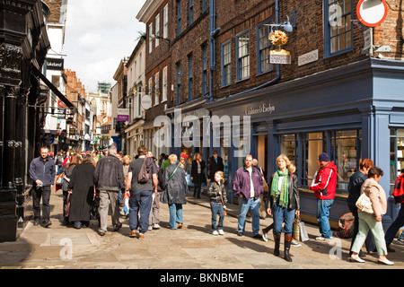 View along the bustling Stonegate in the centre of York city, Yorkshire, Uk - Stock Photo