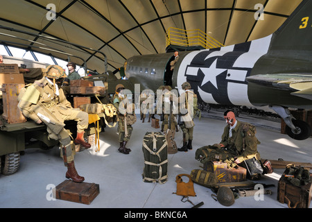Douglas C-47 airplane, uniformes and weapons of the American army in the Airborne Museum at Sainte-Mère-Église, - Stock Photo
