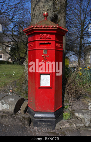 red hexagonal penfold victorian postbox the square Buxton Derbyshire England UK - Stock Photo