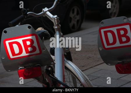 Bicycles for hire seen in Munich, Germany  Operated by DB or Deutsche Bahn and can be unlocked and hired by credit - Stock Photo