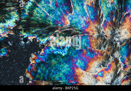 Barytes crystals photographed under a polarising microscope - Stock Photo