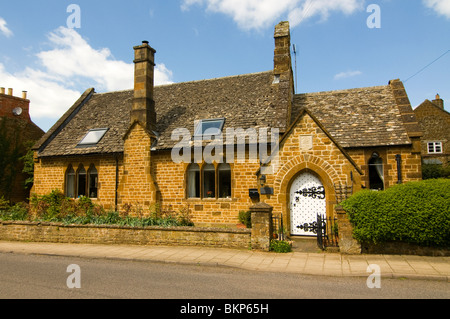 A restored Almshouse in Adderbury, Oxfordshire, now a residential cottage. - Stock Photo
