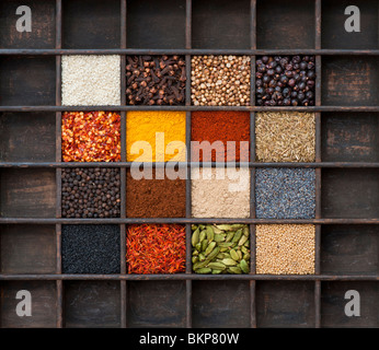 Indian spices in an old wooden tray. Flat lay photography from above - Stock Photo