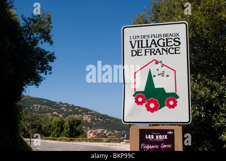 French Government Tourist sign with bullet holes, Corsica - Stock Photo