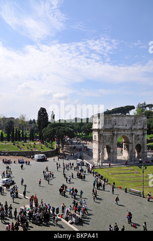 Tourists outside Colosseum near Arch of Constantine, Rome, Italy - Stock Photo