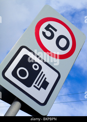 Speed Camera Sign and 50 mph speed limit on a road in the UK - Stock Photo
