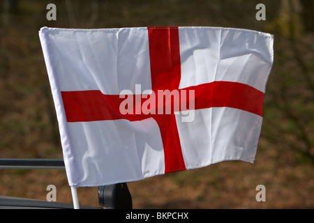 mini cross of St George english national flag flying on a car on st georges day england uk - Stock Photo