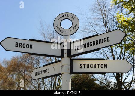 Traditional village signpost in Hampshire Godshill Cross - Stock Photo