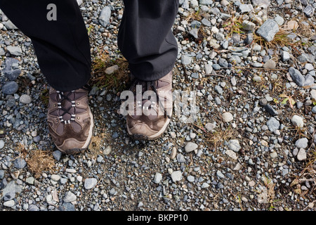 A womens legs and hiking shoes - Stock Photo
