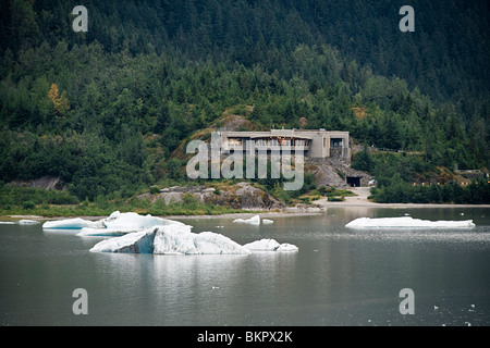 View of the Mendenhall Glacier Visitor Center with icebergs in Mendenhall Lake, Juneau, Alaska - Stock Photo