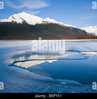 COMPOSITE Scenic view of the Coast Mountains near Juneau reflecting Mendenhall Lake during break up in Spring, Southeast - Stock Photo