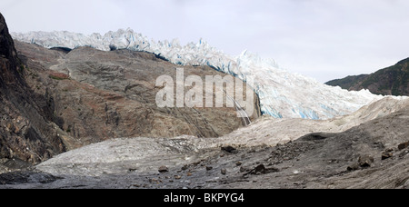 Bedrock is exposed from the retreat of the Mendenhall Glacier revealing a waterfall, Juneau, Alaska - Stock Photo
