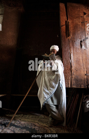 Ethiopia, Lalibela. A priest in one of the ancient rock-hewn churches of Lalibela. - Stock Photo