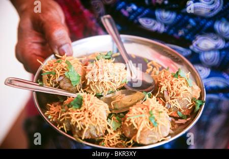 Food being served at the Krishna Temple, Udupi, State of Karnataka, South India - Stock Photo