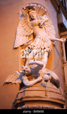 Europe, Malta, Valletta; St.Michael defeating the devil sculpture on a street corner - Stock Photo