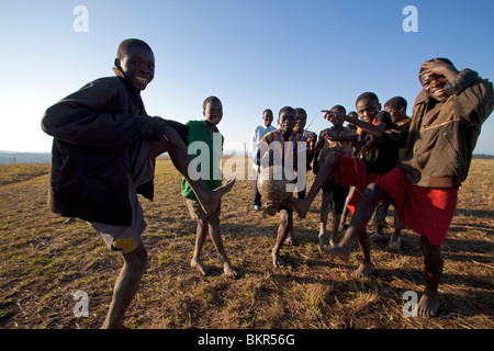 Malawi, Lilongwe, Ntchisi Forest Reserve. The local young football team show off their ball control skills - Stock Photo