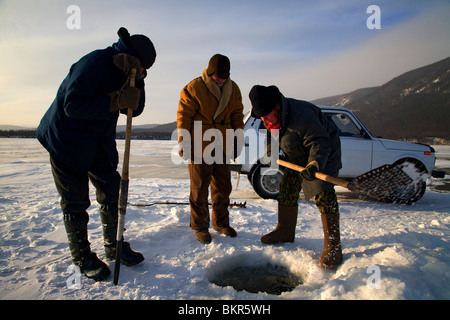 Russia, Siberia, Severo-Baikalsk. Undergoing preparations to fish on frozen Lake Baikal, in Winter the Lake can - Stock Photo
