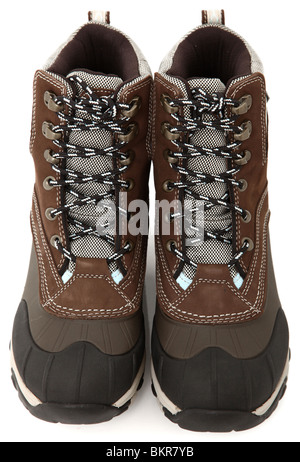 Pair of woman's tie up (lace up) weather proof snow boots over white. Brown, black, blue. - Stock Photo