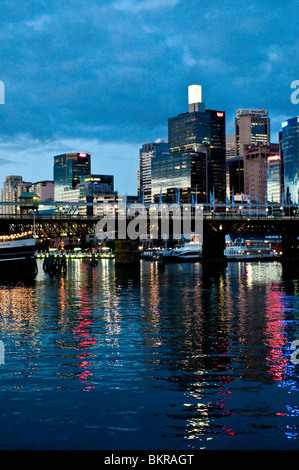 Cockle Bay and CBD buildings at dusk, Darling Harbour, Sydney, Australia - Stock Photo
