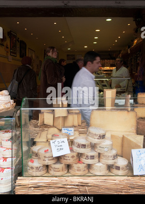 A market stall selling cheese in Paris, France. - Stock Photo