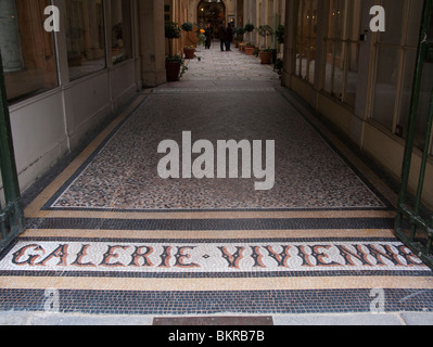 The covered walkway of the Galerie Vivienne shopping arcade in Paris, France - Stock Photo