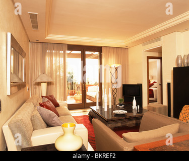 Beige Sofas In Cream Living Room With Black Blinds On Bay Window ...