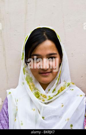 Portrait of a Hunzakut woman. Hunza valley, Pakistan. - Stock Photo