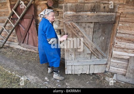 Slovakia, old woman living in the rural Unesco village of Vlkolinec - Stock Photo